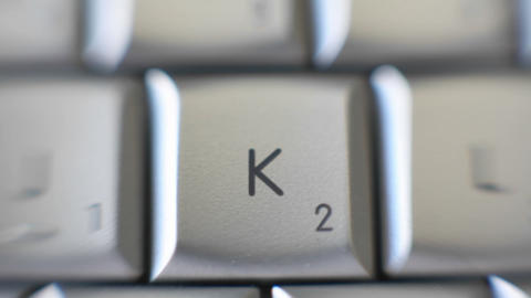 The letter K is brought out on a computer keyboard Stock Video Footage