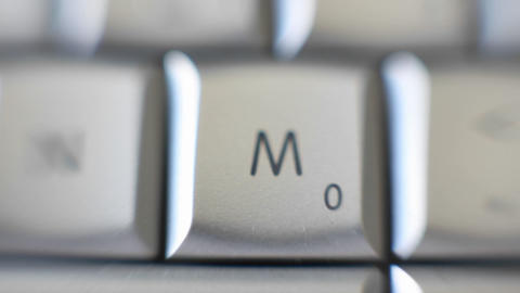 The letter M is on a computer keyboard Footage