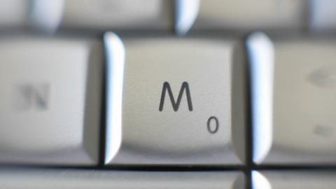 The letter M is on a computer keyboard Stock Video Footage