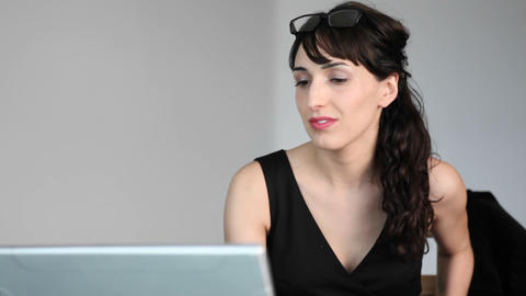 A woman types on her laptop Stock Video Footage