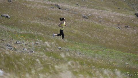 A woman is jogging on a rough dirt path Stock Video Footage