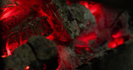 Charcoal fire burning 4k close up video background. Coal ashes barbecue grill Footage