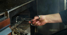 Chef prepares bone steak 4k video: takes meat from grill charcoal barbecue oven Footage