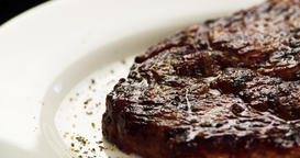 Grilled meat steak on plate 4k rotation close-up video copy space. Fried beef Footage