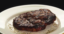 Served grilled meat steak on plate 4k rotation looped video. Fried beef Footage