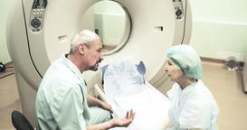 Doctor talks female patient CT MRI diagnostic 4k video. Elderly woman Footage