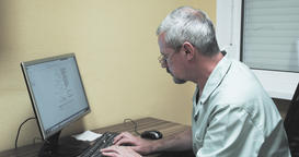 Doctor working at computer 4k video looking at monitor typing keyboard. Hospital Footage