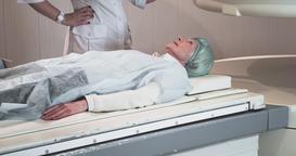 Woman on MRI scanner 4k video. Medical equipment: magnetic resonance machine Footage