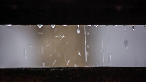 Drops flow from one surface and fall on the other. Slow motion Live Action