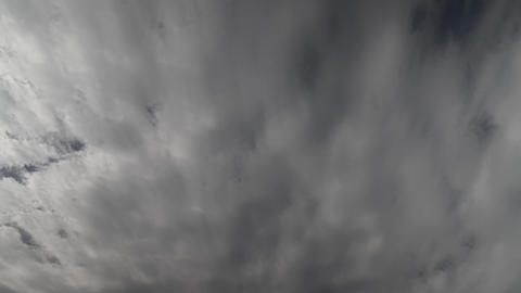 White fluffy clouds pass slowly. Time lapse of the sky with clouds. Abstract cloud moving Live Action