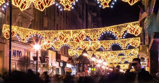 Christmas decorations on a busy street Night crowd passing Time lapse 24fps 4k m Footage