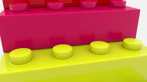 Pyramid of toy bricks in various colors on white Animation