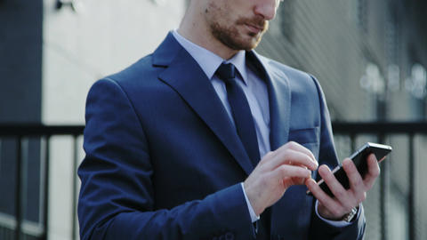 Young Businessman Being Outdoors and Using a Mobile Phone Footage