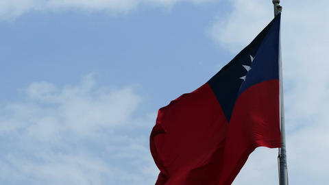 Flag of Taiwan on cloudy blue sky Live Action