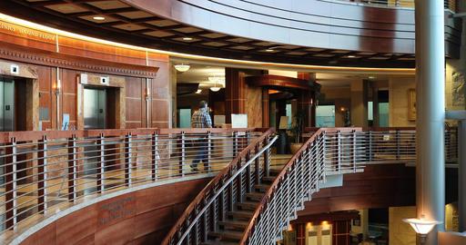 Cancer hospital man walks away balcony stairs DCI 4K 409