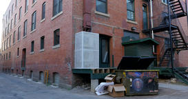Pan of alley with brick buildings Footage