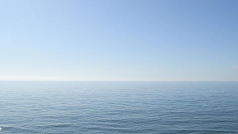 Horizon of blue calm sea with blue sky Live Action
