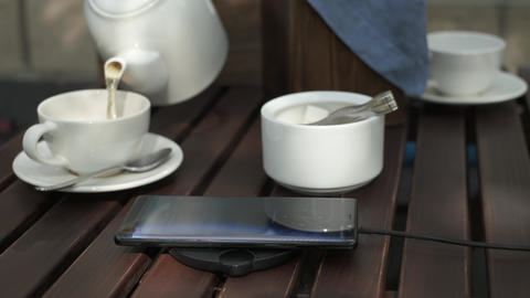 Using wireless smartphone charging in a cafe Live Action