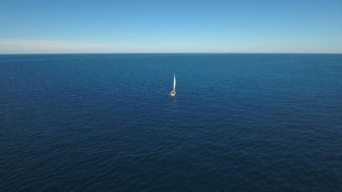Aerial - Two sail boats sailing on deep blue water to an open sea Live Action