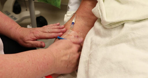 Cancer patient woman with IV in arm before surgery DCI 4K 379 Filmmaterial