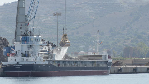 Shovels excavator machine in a industrial ship moving sand in a industrial port Live Action