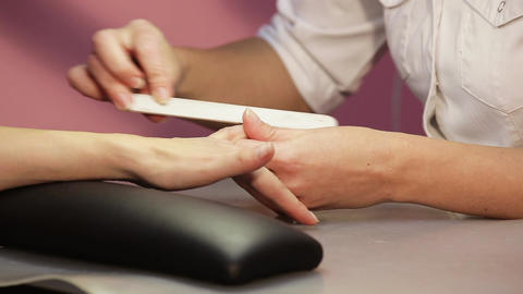 Beautician hand filing nails Live Action