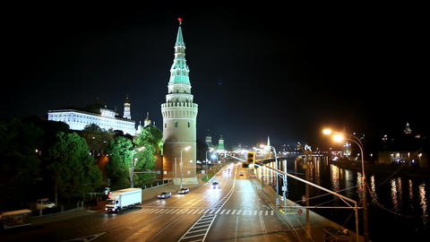 Views of Moscow at night ferry sails at river, movement of cars at the streets Footage