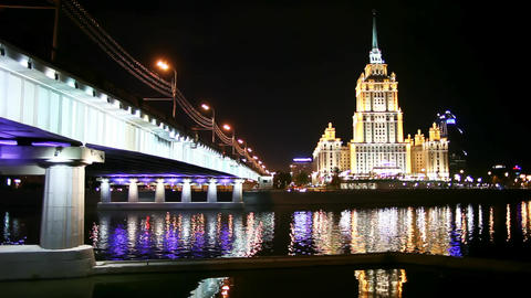 Views of Moscow at night ferry sails under the bridge Footage