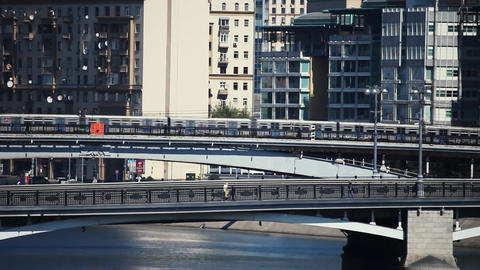 Metro train moves bridge over the river in the city of Moscow Footage