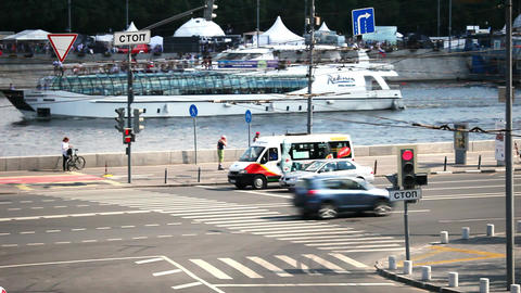 Movement of cars and ships in the city on the streets and rivers of Moscow Footage