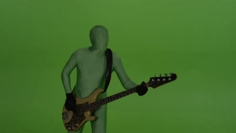 Guitar player on chroma key background, dressed in a greenscreen suit Footage