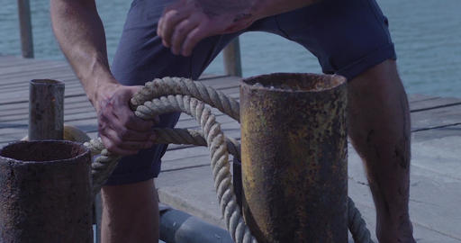 Captain on deck of large ship raises sails. Sailor at the helm of a sailboat. Sa Footage
