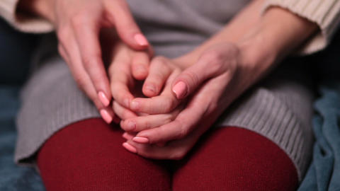 Close up of woman's and girl's hands caressing Footage