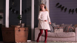 Dancing little girl with headphones at home Footage