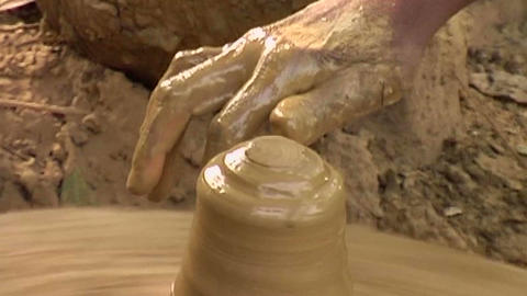 Close up of making clay product using wheels by an artisan Footage