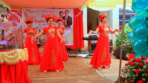 Vietnamese Hostesses in National Dresses Dance on Stage Footage
