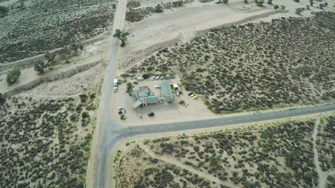 Crossroads in the desert. Aerial view. Car driving along empty countryside road  Footage