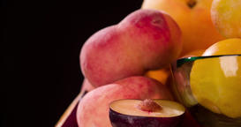 Still life peach plum fruits jam grocery rotation 4k looped video intro copy spa Footage
