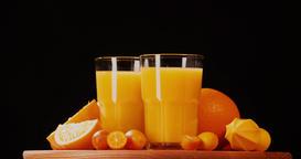 Still life citrus orange juice fruits rotation 4k looped video intro copy space Footage