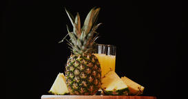 Still life pineapple juice glass fruits composition rotation 4k looped intro vid Footage