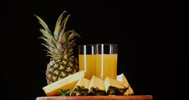 Still life pineapple juice fruits rotation 4k looped intro video copy space Footage