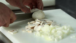 Chef hand cutting with knife champignon mushrooms 4k close up video Footage
