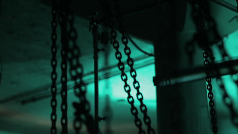 A lot of chins in the location. Room full of chains. Chains in dark space Footage