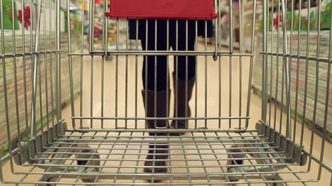 Girl walking with shopping cart in shop Stock Video Footage