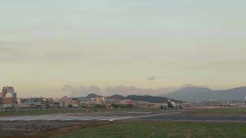 Airplane taxxiing down runway Footage