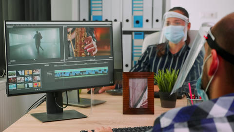 Paralysed man videographer with face mask arguing with colleague Live Action