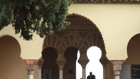 Nasrid ancient arcs in the ancient palace of the Alcazaba, Malaga, Spain Live Action
