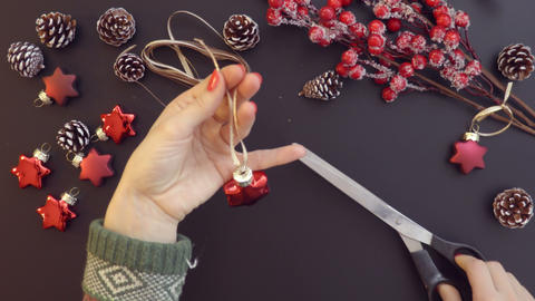 Top view preparing Christmas decoration on the table hands from above Footage
