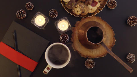Top view steam from the hot coffee on the table with Christmas decoration from a Footage
