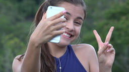 Teen Girl Taking Selfy With Cell Phone Live Action